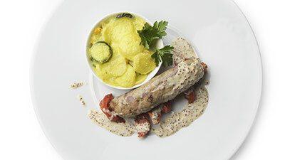 Andouillette au canard et gratin de duo de courgettes et pomme de terre