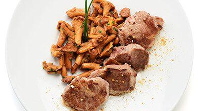 Pluma de porc ibérique et girolles entières